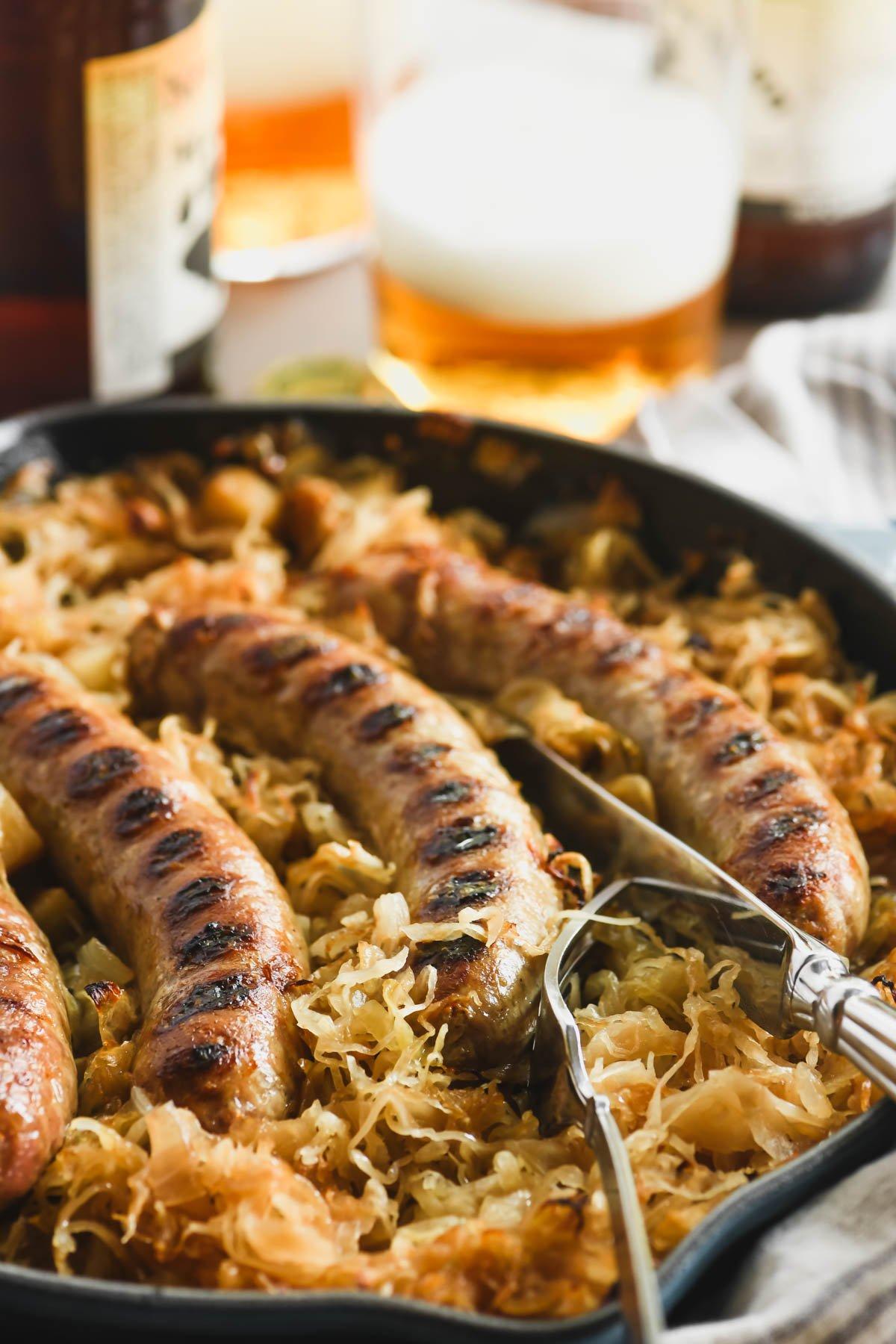 baked bratwurst sausage in sauerkraut