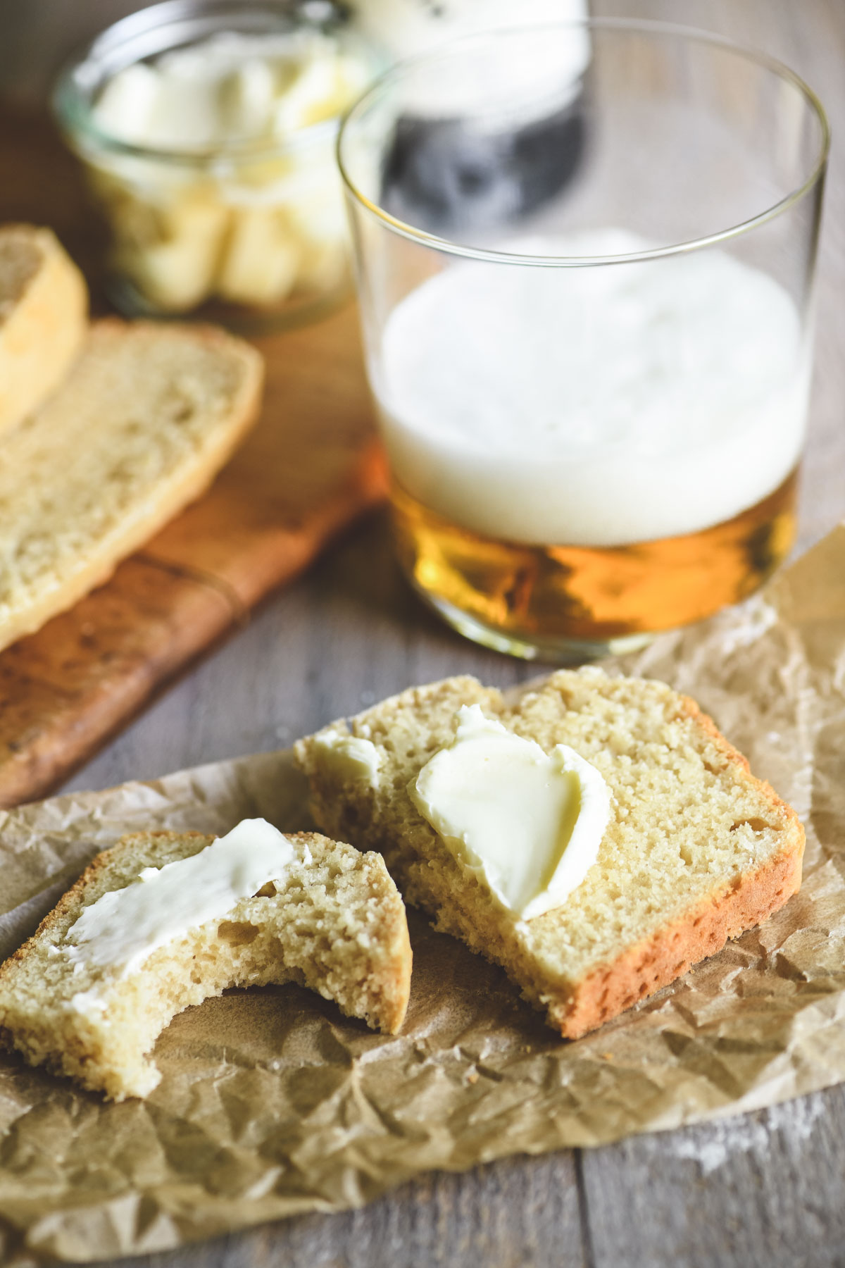 Beer bread with butter, and a glass of beer