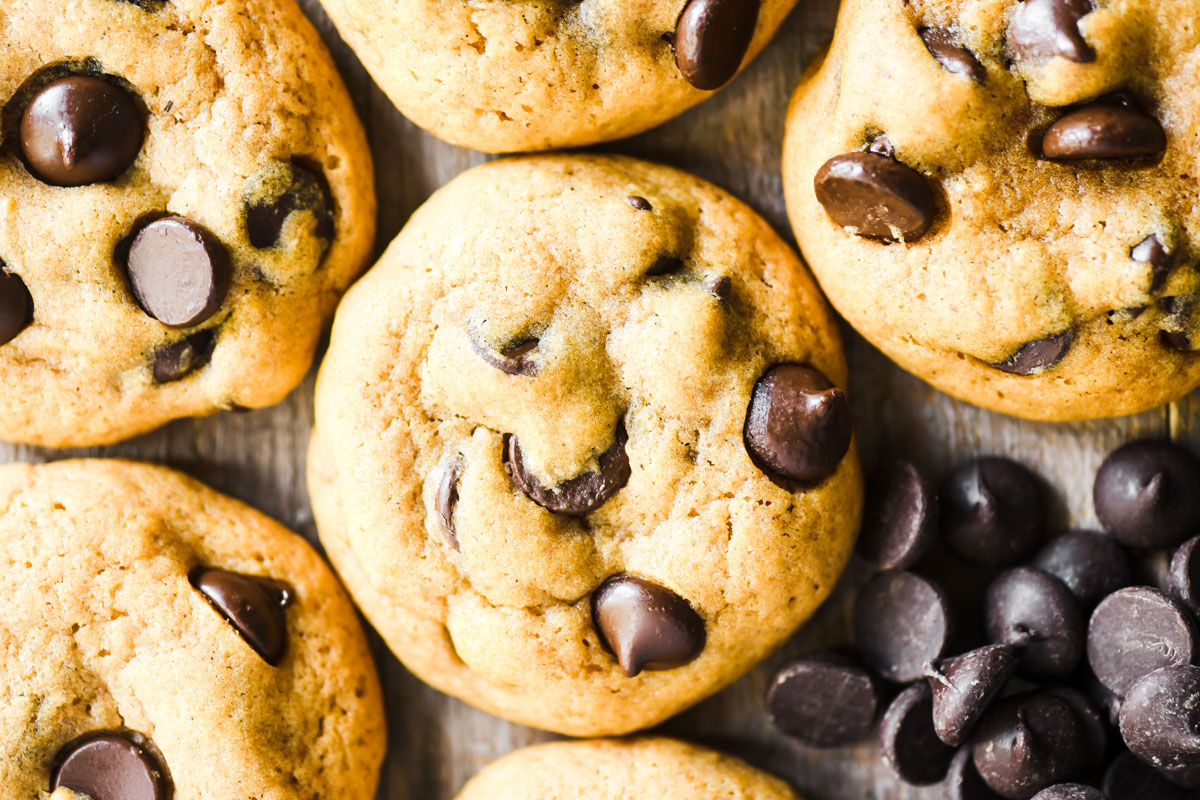 chocolate chip pumpkin cookies, with dark chocolate chips on a wooden board