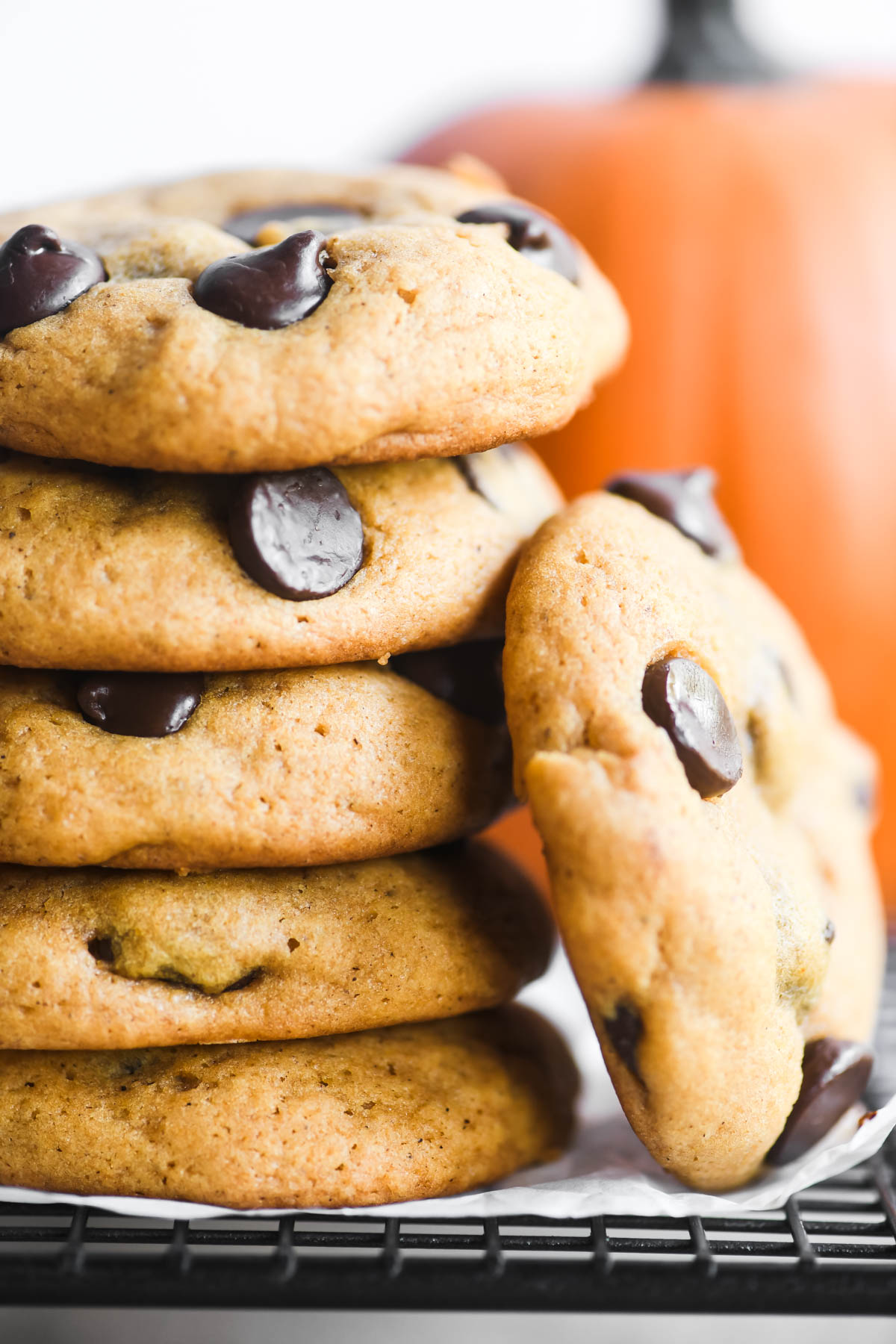 a stack of chocolate chip pumpkin cookies