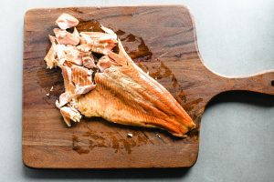 Breaking smoked trout into pieces