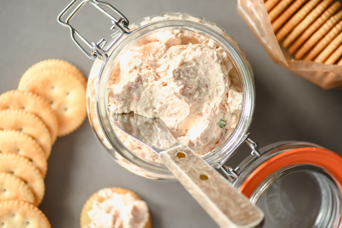 smoked trout dip in a jar with Ritz crackers