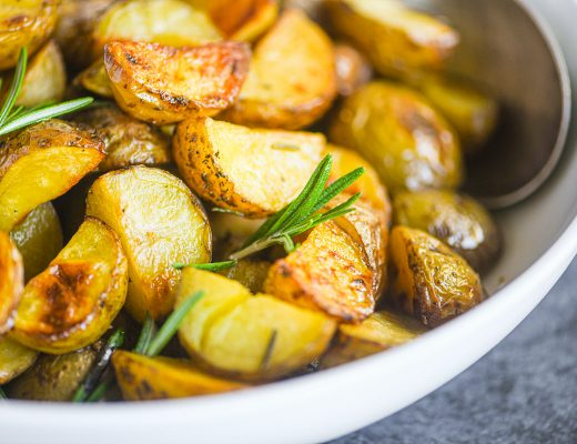 oven roasted potatoes with rosemary in a bowl