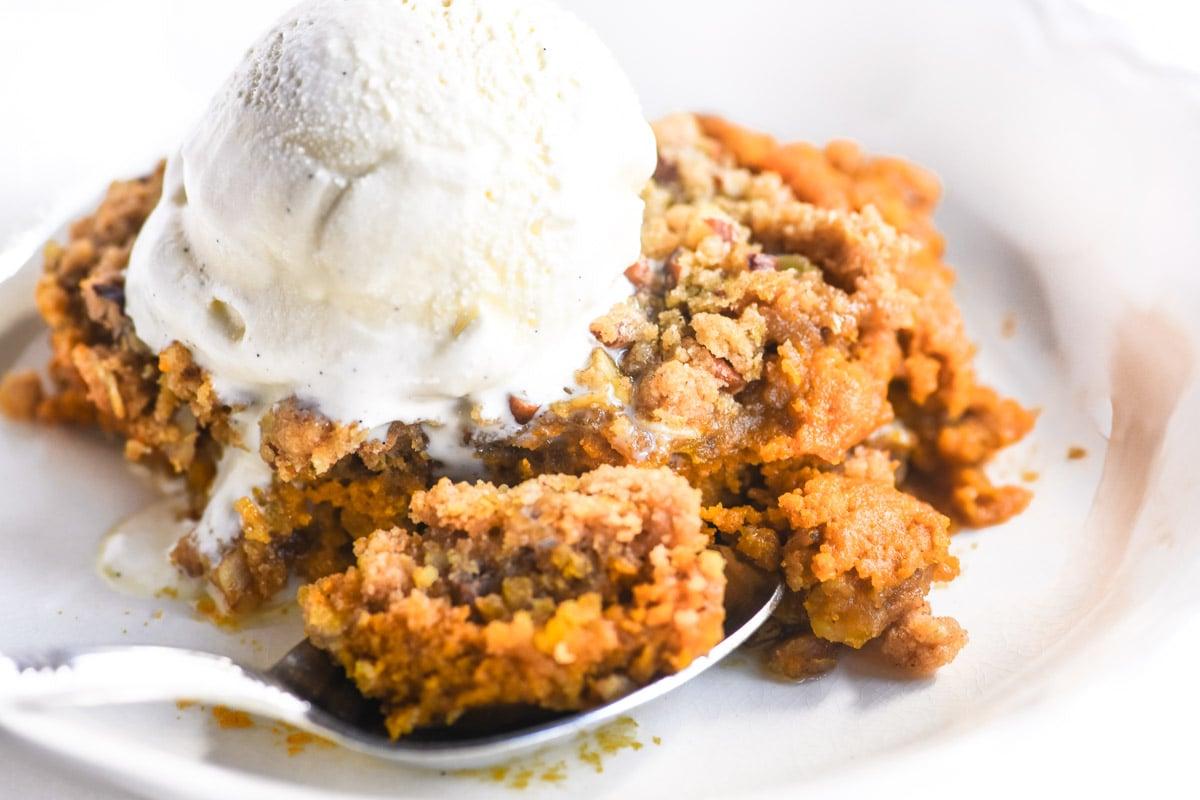 pumpkin Spice Crisp in a bowl with ice cream